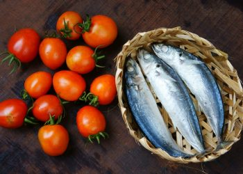 Veitnamese food braised fish with tomato a popular dish in Vietnam meal cheap tasty nutrition and fresh raw material fish stew with fish sauce sugar season with tomato spice